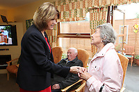 """NO REPRO FEE. 21/11/2011. New Alzheimer Day Centre at full capacity as demand for Alzheimer services grow. Minister for Social Protection Joan Burton T.D. officially opened """"Failte Day Centre"""", which will provide dementia-specific, person-centred care to people with dementia and their carers in Hartstown, Clonsilla. The Minister is pictured with client Con Hegarty and wife Peggie Hegarty from Castleknock. The Alzheimer Society of Ireland, in partnership with the HSE, is currently operating 3 days a week caring for clients living with dementia who live in Castleknock. Picture James Horan/Collins Photos"""