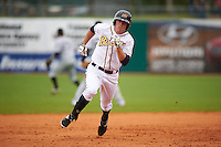 Montgomery Biscuits outfielder Kes Carter (10) running the bases during a game against the Jackson Generals on April 29, 2015 at Riverwalk Stadium in Montgomery, Alabama.  Jackson defeated Montgomery 4-3.  (Mike Janes/Four Seam Images)