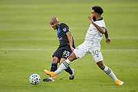 SAN JOSE, CA - SEPTEMBER 16: Judson #93 of the San Jose Earthquakes passes the ball under pressure from Eryk Williamson #30 of the Portland Timbers during a game between Portland Timbers and San Jose Earthquakes at Earthquakes Stadium on September 16, 2020 in San Jose, California.
