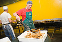"""SAGRA DEL """"PESCE E PATATE"""" 2011, BARGA, ITALY<br /> <br /> THE FISH AND CHIPS ARE PREPARED BEHIND THE SCENES."""