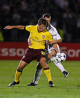 Arsenal player Andrey Arshavin, left in action against Ivan Stevanovic, from Partizan,  during  UEFA Champions league match in group H FC Partizan Belgrade Vs. Arsenal, London, Serbia, Monday, Sept. 28, 2010.  (Srdjan Stevanovic/Starsportphoto.com)