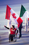 Sochi, RUSSIA - Mar 16 2014 - Closing Ceremonies flag bearer Josh Dueck at the 2014 Paralympic Winter Games in Sochi, Russia.  (Photo: Matthew Murnaghan/Canadian Paralympic Committee)