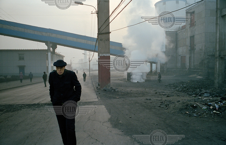 Workers at a large state-owned coal mine, which is a major contributor to air pollution in the region.  Shanxi is the largest producer of coal in China.  The rate of coal mining in the country is increasing from an annual production of over 2 billion tons in order to cater for China's rapid economic growth.