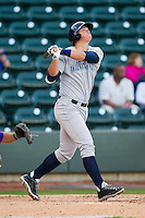 Murray Watts (34) of the Wilmington Blue Rocks follows through on his swing against the Winston-Salem Dash at BB&T Ballpark on April 20, 2013 in Winston-Salem, North Carolina.  The Dash defeated the Blue Rocks 4-2 in game one of a double-header.  (Brian Westerholt/Four Seam Images)