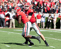 ATHENS, GA - OCTOBER 12: Jake Fromm #11 of the Georgia Bulldogs hands the ball of to Zamir White #3 of the Georgia Bulldogs during a game between University of South Carolina Gamecocks and University of Georgia Bulldogs at Sanford Stadium on October 12, 2019 in Athens, Georgia.