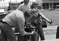 """Actress Jodie Foster, age 14, goes behind the camera while on location shooting """"Americans,"""" a documentary by Desmond Wilcox. Los Angeles, June, 1977. Photo by John G. Zimmerman"""