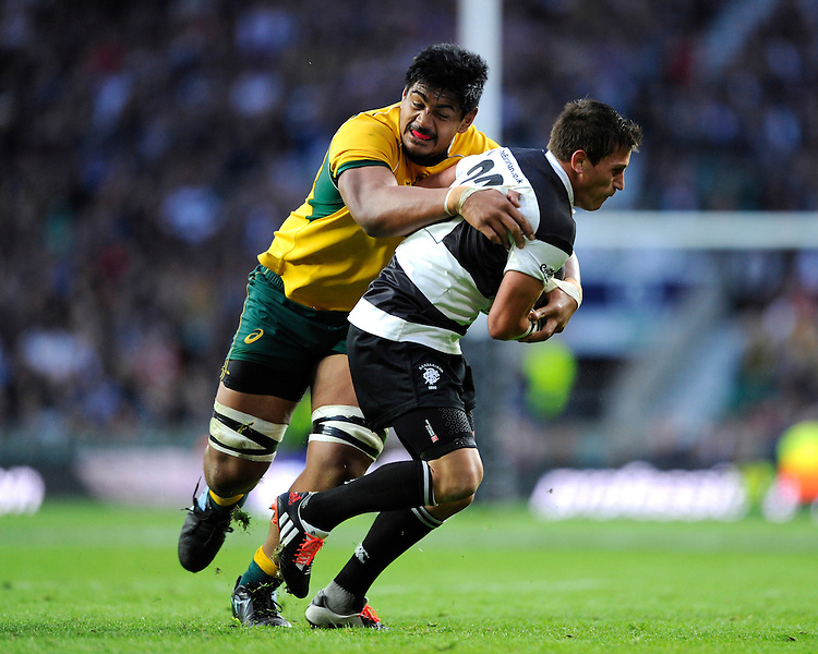Will Skelton of Australia tackles Marnitz Boshoff of Barbarians during the Killik Cup match between Barbarians and Australia at Twickenham Stadium on Saturday 1st November 2014 (Photo by Rob Munro)