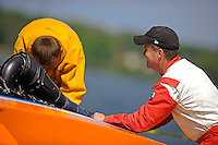 """Dan Kanfoush, Y-1 """"Fast Eddie Too"""" talks with competitor Sean Bowsher Y-52 as he works on his boat.  (1 Litre MOD hydroplane(s)"""