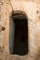 Tarmeisa, Libya - An Abandoned Berber Village in the Jebal Nafusa.  Mosque Entrance.  Byzantine symbols to the right of the door suggest that this was once a church.