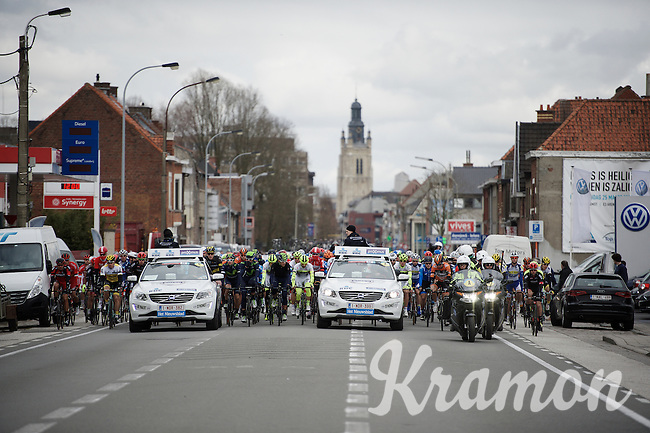 peloton leaving the start town of Roeselare and getting escorted towards the official start zone<br /> <br /> 71st Dwars door Vlaanderen (1.HC)
