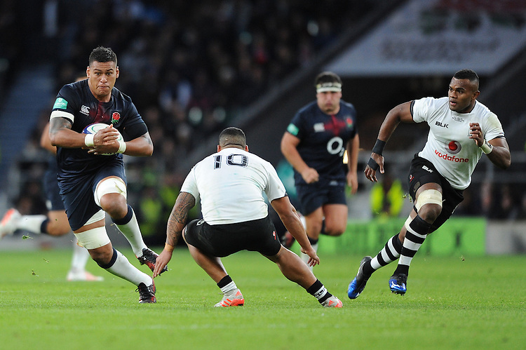 Nathan Hughes of England in action against Josh Matavesi of Fiji during the Old Mutual Wealth Series match between England and Fiji at Twickenham Stadium on Saturday 19th November 2016 (Photo by Rob Munro)