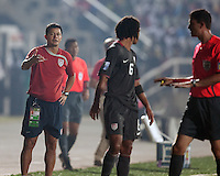 Wilmer Cabrera talks to Zachary Herold during the match. Spain defeated the U.S. Under-17 Men National Team  2-1 at Sani Abacha Stadium in Kano, Nigeria on October 26, 2009.