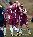 Alloa's Calum Elliot (9) is congratulated by Martin Grehan (11) after he scores their second goal.