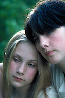 Portrait of two adolescent sisters blonde and brunette, in a moody pose. Mara and Shoshona. Massachusetts.