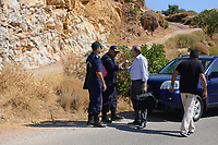 Pictured: Pathologist Nikos Karakoukis (3rd L) arrives at the scene in Ikaria, Greece. Thursday 08 August 2019<br /> Re: Rescuers searching for  British scientist Natalie Christopher, 35, who disappeared on the  island of Ikaria, Greece have found her body at the bottom of a ravine.<br /> She was found less than a mile from the hotel in the Kerame area where she was on holiday with her Cypriot partner.<br /> Emergency service staff said that a large rock had dislodged as she fell, causing multiple head injuries.<br /> The woman's body will be kept overnight at the spot so a coroner can examine it on Thursday morning.