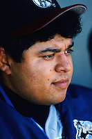 Dennys Reyes of the San Bernardino Stampede sits in the dugout during  a game against the Lake Elsinore Storm during the 1996 baseball season at The Diamond in Lake Elsinore, California. (Larry Goren/Four Seam Images)