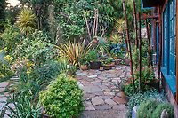 Patio with recycled concrete pavers; Roger Raiche Berkeley Maybeck Cottage garden