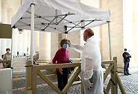 A woman undergoes body temperature scanning while going through security to access St. Peter's Square and Basilica on May 18, 2020 at the Vatican in the day of the reopening of St. Peter's Basilica. Italy is slowly lifting sanitary restrictions after a two-month coronavirus lockdown.<br /> UPDATE IMAGES PRESS/Isabella Bonotto<br /> <br /> STRICTLY ONLY FOR EDITORIAL USE