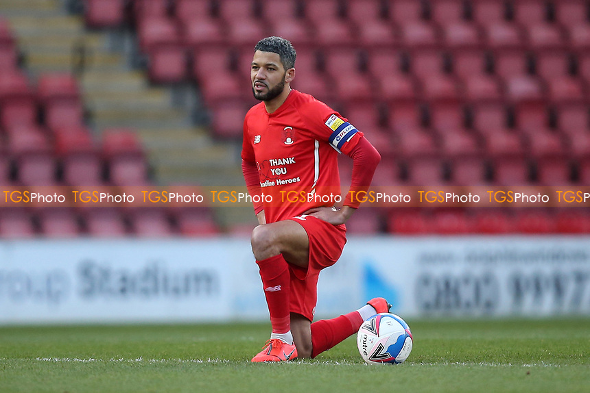 Jobi McAnuff of Leyton Orient takes the knee during Leyton Orient vs Salford City, Sky Bet EFL League 2 Football at The Breyer Group Stadium on 2nd January 2021