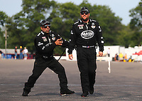 Aug. 18, 2013; Brainerd, MN, USA: NHRA top fuel dragster driver Khalid Albalooshi (left) jokes with teammate Shawn Langdon during the Lucas Oil Nationals at Brainerd International Raceway. Mandatory Credit: Mark J. Rebilas-