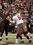 December 2009: Tampa Bay Buccaneers quarterback Josh Freeman (5) passes the ball during an NFL football game at the Louisiana Superdome in New Orleans.  The Buccaneers defeated the Saints 20-17.