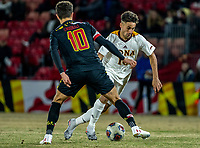 COLLEGE PARK, MD - NOVEMBER 21: Najim Romero #10 of Iona slips past Eli Crognale #10 of Maryland during a game between Iona College and University of Maryland at Ludwig Field on November 21, 2019 in College Park, Maryland.