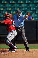 Umpire Robert Nunez strikeout call behind catcher Carlos Martinez (54) during a Southern League game between the Mississippi Braves and Jackson Generals on July 23, 2019 at The Ballpark at Jackson in Jackson, Tennessee.  Jackson defeated Mississippi 2-0 in the first game of a doubleheader.  (Mike Janes/Four Seam Images)