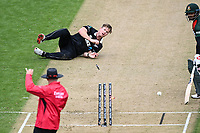 20th March 2021; Dunedin, New Zealand;  Jimmy Neesham runs out Mohammad Mithun.<br />