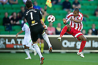 MELBOURNE, AUSTRALIA - January 2:  Alex Terra of the Heart and Justin Pasfield of the Fury compete for the ball during the round 21 A-League match between Melbourne Heart and North Queensland Fury at AAMI Park on January 2, 2011 in Melbourne, Australia. (Photo by Sydney Low / Asterisk Images)