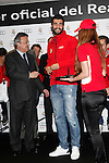 Real Madrid player Raul Albiol (r) and the President Florentino Perez participate and receive new Audi during the presentation of Real Madrid's new cars made by Audi at the Jarama racetrack on November 8, 2012 in Madrid, Spain.(ALTERPHOTOS/Harry S. Stamper)