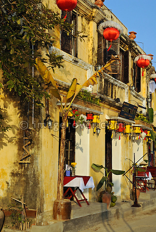 Asia, Vietnam, Hoi An. Hoi An old quarter. Tastefully arranged tables at the restaurant Hoa Vang on the Bach Dang river promenade. The historic buildings, attractive tube houses, and decorated community halls have 1999 earned Hoi An's old quarter the status of a UNESCO World Heritage Site. To protect the old quarter's character stringent conversation laws prohibit alterations to buildings, as well as the presence of cars on the roads.