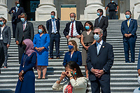 Members of Congress on the House steps of the US Capitol stand at a safe distance during a press conference ahead of the vote on the George Floyd Justice in Policing Act of 2020 in Washington, DC., Thursday, June 25, 2020. Credit: Rod Lamkey / CNP/AdMedia