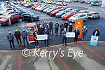 The staff of Kellihers Toyota present a cheque of €5,852.51 to both Recovery Haven and  Comfort for Chemo from their recent Shave and Dye fundraiser.