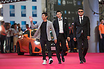 Cao Weiyu (sunglasses), Xing Aowei (grey jacket), Jarvis Wu (necktie) walk the Red Carpet event at the World Celebrity Pro-Am 2016 Mission Hills China Golf Tournament on 20 October 2016, in Haikou, China. Photo by Victor Fraile / Power Sport Images