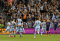 KANSAS CITY, KS - SEPTEMBER 11: Sporting Kansas City celebrates their first goal at the beginning of the first half during a game between Chicago Fire FC and Sporting Kansas City at Children's Mercy Park on September 11, 2021 in Kansas City, Kansas.
