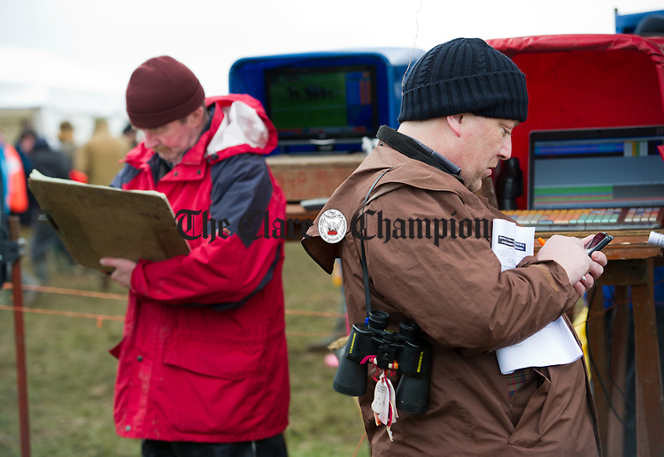 Paul Mc Learn weighs up his chances against the bookies at the East Clare Harriers Hunt Point To Point at Garranboy, Killaloe. Photograph by John Kelly.
