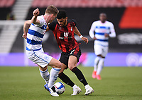 17th October 2020; Vitality Stadium, Bournemouth, Dorset, England; English Football League Championship Football, Bournemouth Athletic versus Queens Park Rangers; Dominic Solanke of Bournemouth competes for the ball with Rob Dickie of Queens Park Rangers