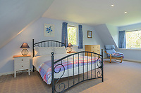 """BNPS.co.uk (01202) 558833. <br /> Pic: KnightFrank/BNPS<br /> <br /> Pictured: Holiday let bedroom. <br /> <br /> A castle that was burnt down by a pirate, involved in the English Civil War and has been in the same family for five centuries is on the market for offers over £650,000.<br /> <br /> Kilberry Castle, which dates back to the 15th century, has an incredible history and still has a wealth of original features including a 288-year-old mausoleum.<br /> <br /> It sits in 21 acres of land on the Scottish west coast, with stunning views over Kilberry Bay and out to the islands of Islay, Jura and Gigha.<br /> <br /> The four-storey tower house now needs a buyer """"with deep pockets and great imagination"""" to carry out a complete refurbishment but it has a lot of potential."""
