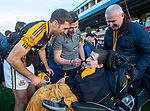 Gary Brennan and Paul Flanagan of Ballyea say hello to the team's biggest fan Colin Barry and his dad following the county senior hurling final against Cratloe at Cusack Park. Photograph by John Kelly.