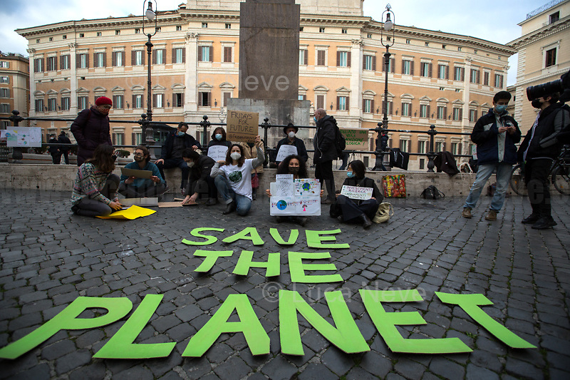 "Rome, Italy. 19th Feb, 2021. Today, Fridays For Future Roma (1.) held a sit-in outside the Italian Parliament in Piazza Montecitorio called ""The Transition We Want"". The aim of the rally was to call the new Italian Government, led by Professor Mario Draghi, to act for an immediate plan, investments and policies against the so called ""climate changes"" and the consequent climate crisis. The ""Fridays for Future"" actions are a series of global demonstrations directly related to Greta Thunberg (2.), the 16 year old ""Swedish political activist seeking to stop global warming and climate change, [who] in August 2018 became a prominent figure for starting the first school strike for climate, outside the Swedish parliament building"" (source Wikipedia.org, 3.). <br />