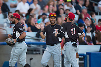 Salem-Keizer Volcanoes center fielder Aaron Bond (51) congratulates right fielder Dalton Combs (31) after robbing a home run during a Northwest League game against the Hillsboro Hops at Ron Tonkin Field on September 1, 2018 in Hillsboro, Oregon. The Salem-Keizer Volcanoes defeated the Hillsboro Hops by a score of 3-1. (Zachary Lucy/Four Seam Images)