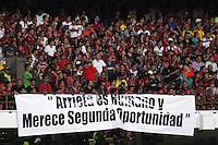 CUCUTA - COLOMBIA -07 -02-2015: Hinchas de Cucuta Deportivo, animan a su equipo durante partido entre Cucuta Deportivo e Independiente Santa Fe por la fecha 2 de la Liga Aguila I-2015, jugado en el estadio General Santander de la ciudad de Cucuta.  / Fans of Cucuta Deportivo, cheer for their team during a match between Cucuta Deportivo and Independiente Santa Fe for the date 2 of the Liga Aguila I-2015 at the General Santander Stadium in Cucuta city, Photo: VizzorImage / Manuel Hernandez / Str.