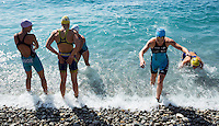 16 SEP 2012 - NICE, FRA -  Felicity Abram (second from right) of TCG 79 Parthenay leaves the water after a warm up swim before the start of the French Grand Prix triathlon series final stage held during the Triathlon de Nice Côte d'Azur (PHOTO (C) 2012 NIGEL FARROW)