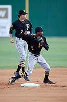 Bristol Pirates shortstop Victor Ngoepe (5) turns a double play in front of second baseman Chase Lambert (2) during a game against the Elizabethton Twins on July 28, 2018 at Joe O'Brien Field in Elizabethton, Tennessee.  Elizabethton defeated Bristol 5-0.  (Mike Janes/Four Seam Images)