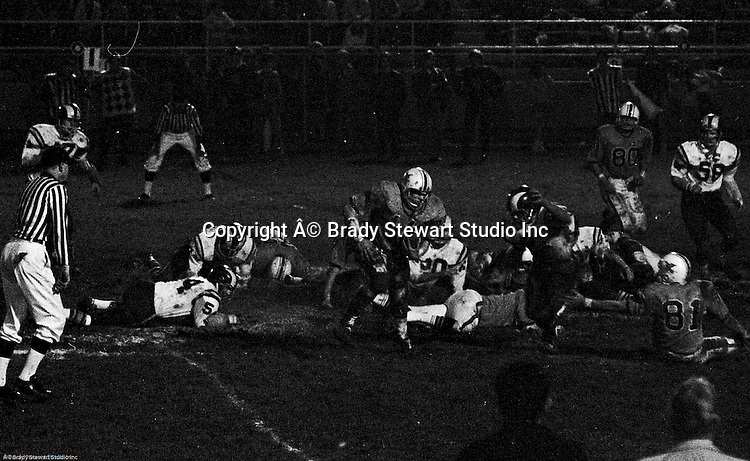 Bethel Park PA:  Offensive play with Mike Stewart 11 running the ball in the mud.  Others in the photo; Gary Biro 81, Bruce Evanovich 80.  The Bethel Park defense recovered 5 fumbles but the offense was not able to score against the Mt Lebanon Defense.  The field conditions were horrendous, after every play you had to get the sawdust out of your eyes. After a highly disputed non-TD call by Art Walker's brother-in-law, the undefeated Mt Lebanon Blue Devils ended up winning the Western Conference.  The defensive unit was one of the best in Bethel Park history only allowing a little over 7 points a game.
