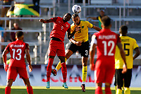 July 16th 2021; Orlando, Florida, USA; Guadeloupe forward Raphael Mirval and Jamaica defender Michael Hector challenge for the ball during the Concacaf Gold Cup match between Guadeloupe and Jamaica on July 16, 2021 at Exploria Stadium in Orlando, Fl.