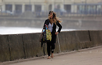 WINDY WEATHER WALES<br /> Pictured: A woman is windswept as she strolls in Porthcawl, south Wales, UK. Tuesday 06 June 2017<br /> Re: Strong winds have been affecting parts of the UK