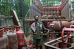 Gourav Kr. Roy poses for a photo. He is a cokking gas delivery boy and presently on emergency duty during 21 days lock down in India due to covid 19 pandemic. Kolkata, West Bengal, India. Arinda Mukherjee