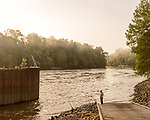 May 5, 2018. Riegelwood, North Carolina.<br /> <br /> A fisherman waits by his lines at Lock and Dam #1 on the Cape Fear River. Wilmington, the largest city effected by the GenX contamination of the Cape Fear River, sits 30 miles downstream and pipes the water from just north of this dam to the Cape Fear Public Utility Authority water treatment plant to avoid salt water contamination downstream. <br /> <br /> The Chemours Company, a spin off from DuPont, manufactures many chemicals at its plant in Fayetteville, NC. One of these, commonly referred to as GenX, is part of the process of teflon manufacturing. Chemours has been accused of dumping large quantities of GenX into the Cape Fear River and polluting the water supply of city's down river and allowing GenX to leak into local aquifers.
