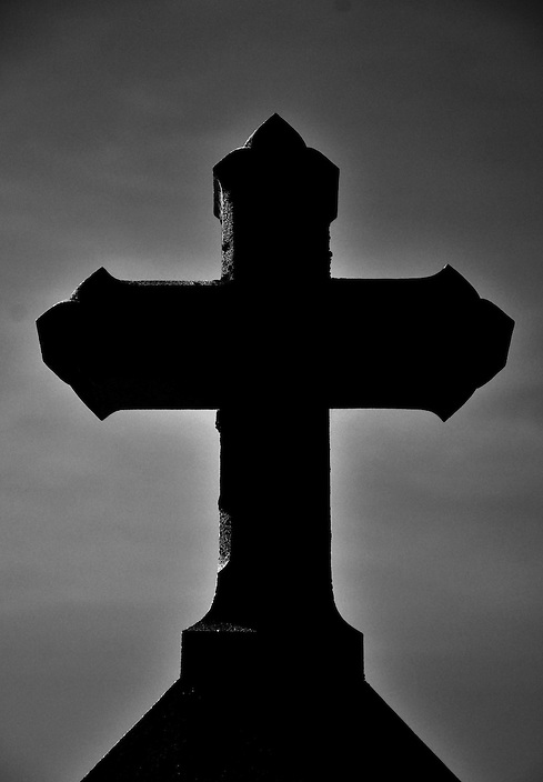 A B+W conversion of a cemetery headstone carved in the shape of a cross. This image is part of a continuing series featuring amazing headstones from all over New England.
